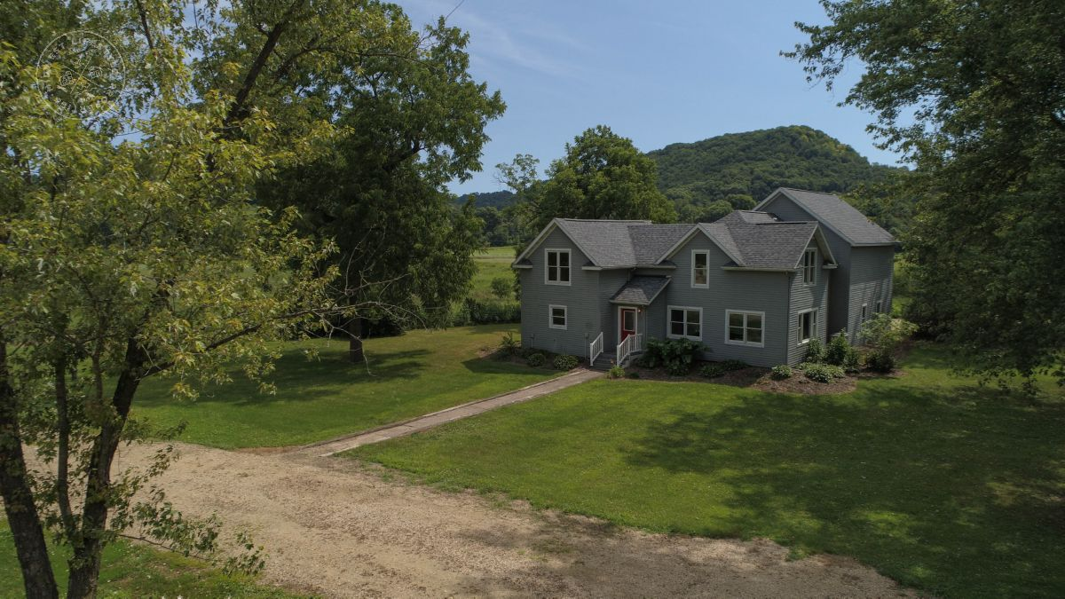 Remodeled Farmhouse with Trout Stream and Organic Tillable Minutes from La Crosse