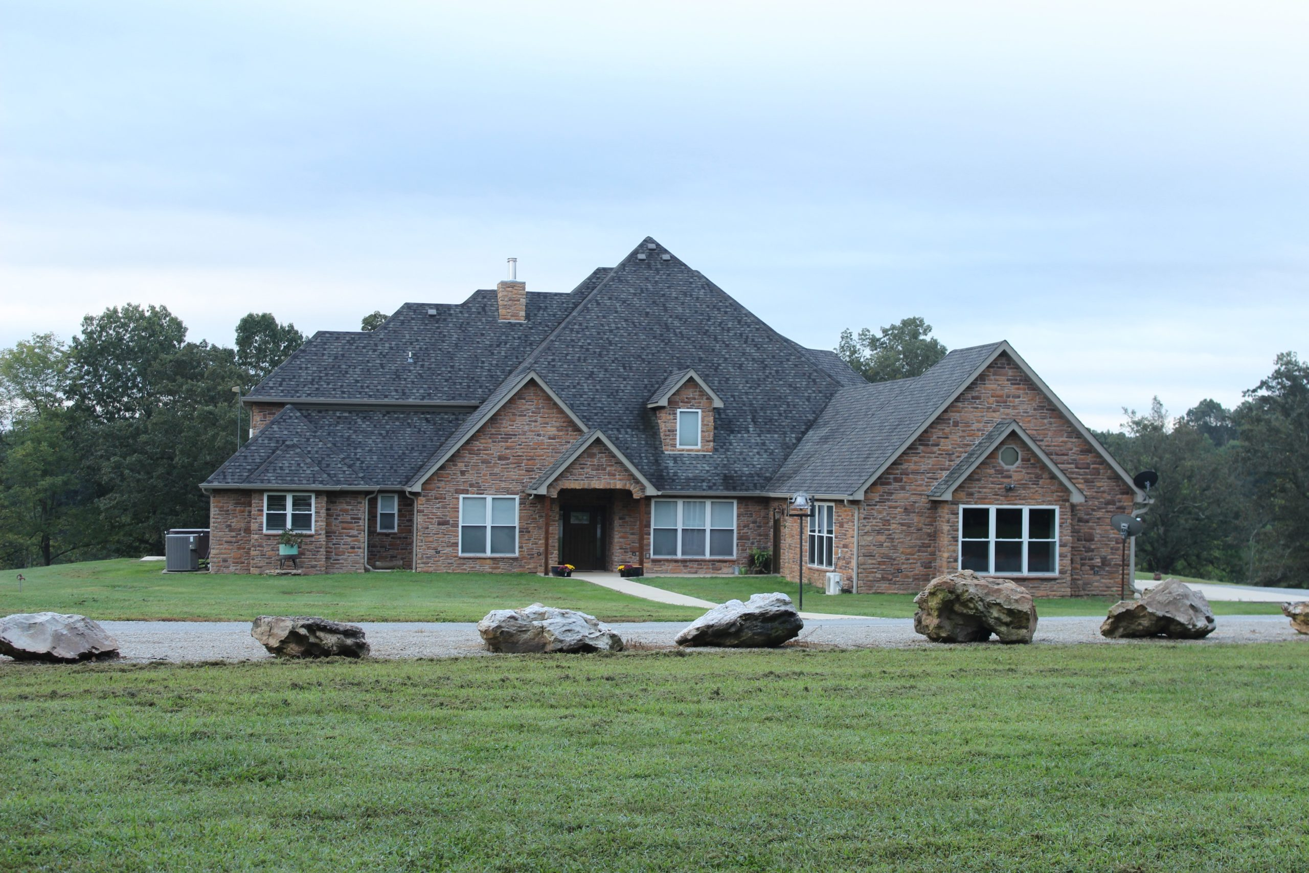 Executive-Style Stone Home with Acreage for sale in the Missouri Ozarks