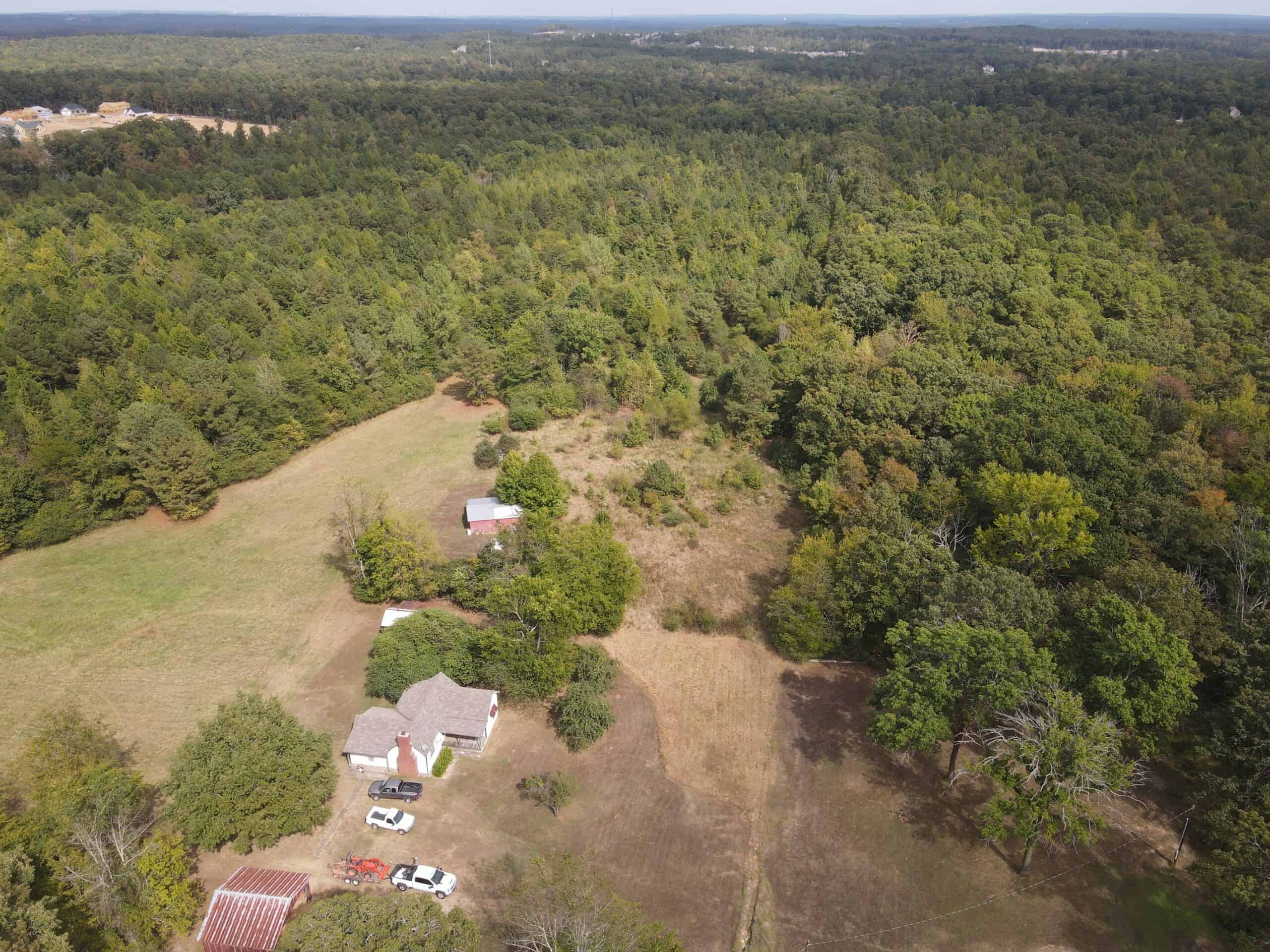 Development Land with Timber For Sale in Alexander, AR